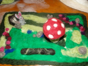 Spring seasonal needle felted mat.